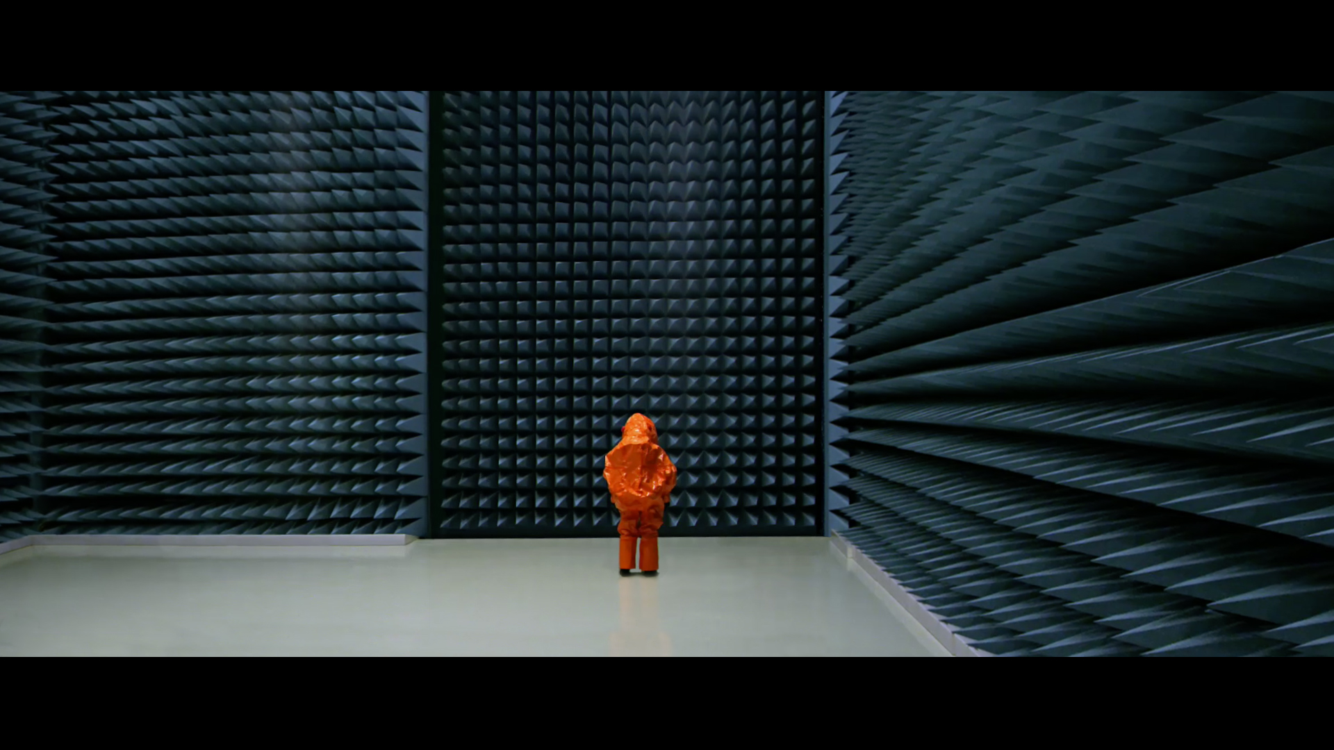 THE VISIT_Main still_ Orange_man_in_blue_room_(C)Heikki_Faerm